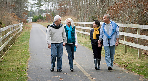 Happy couples strolling in the park after treatment at Eastern Slope Dental